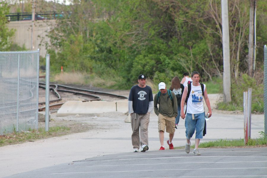 Three members of the homeless community walk towards South Main Street's Cumberland Farms after eating dinner at the Friendly Kitchen on  Wednesday May 21st.
