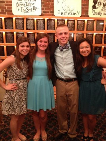 CHS Seniors, Sam Duclos, Elizabeth Donlon, Ryan Donnelly, and Bianca Bernardo take a photo at the Senior Awards Night on June 3, 2014 at the City Auditorium.