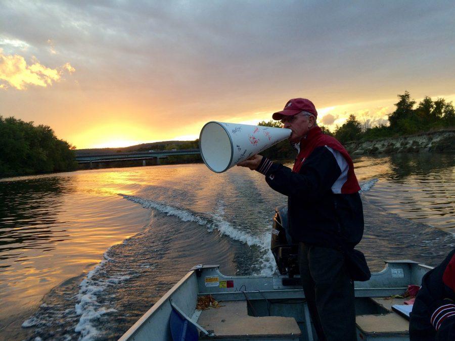 Coach Printzlau coaches Concord Crew's varsity women at sunset.