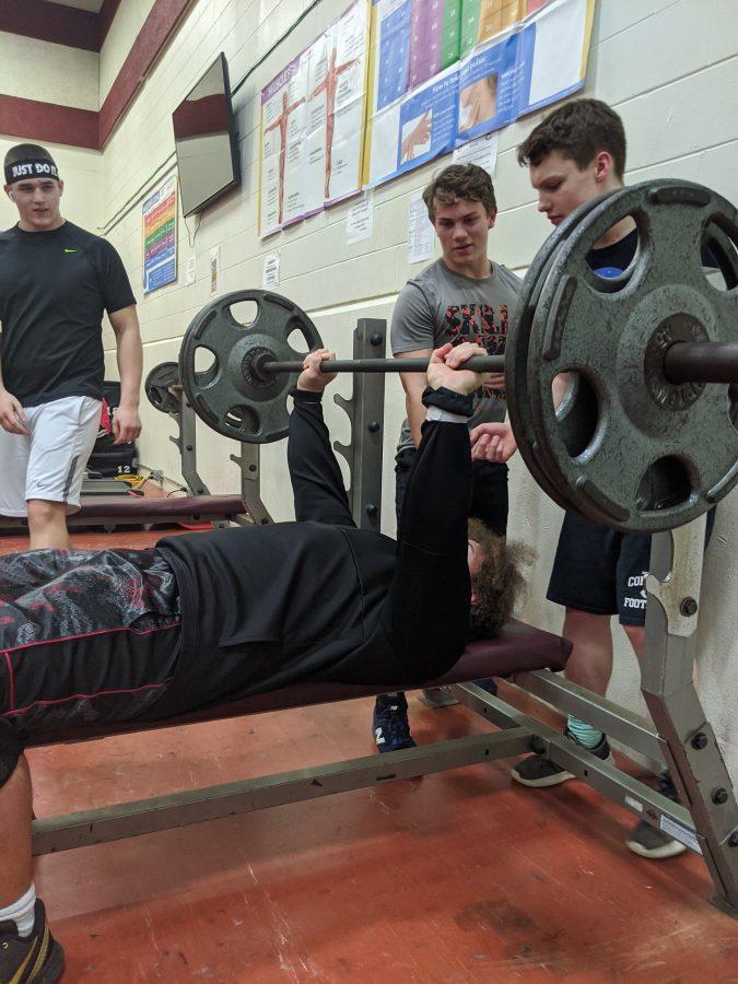 Varsity football building strength for 2020