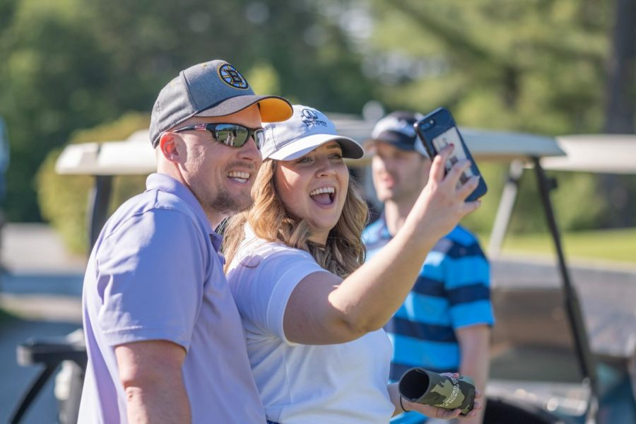 Jonathan Stallsmith and Erika Mattson, Class of '12, catch up at the very first tournament in 2019.