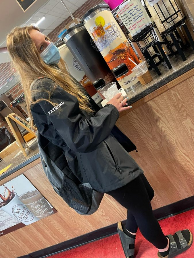 Hailee Raymond buys coffee in the cafeteria